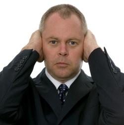 Man covers ears