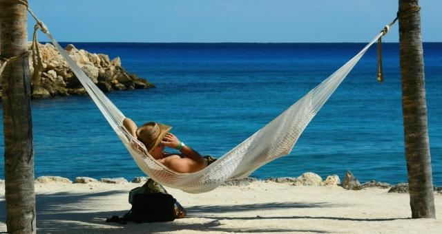 Worker on hammock at beach